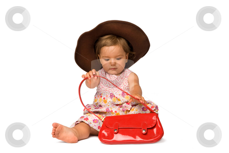 Baby Girl Fashion Model stock photo, One year old fashion model posing with purse and hat, isolated over white background. by Rognar