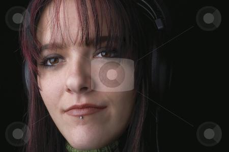 Fashion model - music stock photo, Close up of twenty something fashion model listening to music by Yann Poirier
