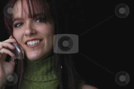 Fashion model - Cell phone stock photo, Close up portrait of a twenty something fashion model smiling with a cell phone in hand by Yann Poirier