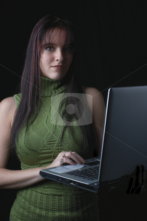Fashion model - Laptop stock photo, Twenty something fashion model working with laptop standing up by Yann Poirier