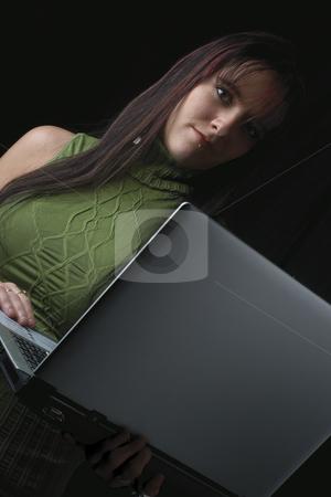 Fashion model - Laptop stock photo, Twenty something fashion model working with laptop standing up by Yann Poirier