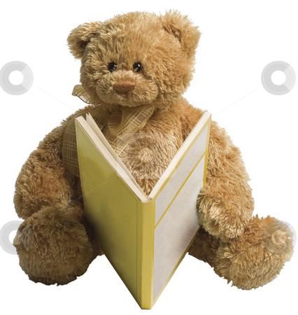 Teddy bear reading stock photo, Small teddy bear reading a yellow book by Yann Poirier