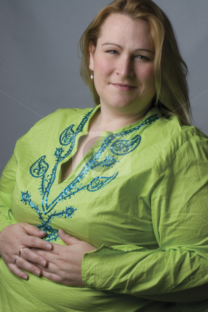 Model in green stock photo, Female model in her thirties, over weight, with green top by Yann Poirier
