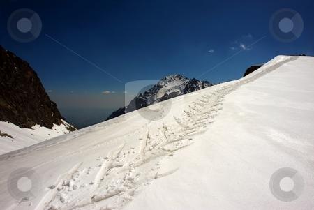 Skiing path in winter mountains stock photo, Skiing path in winter mountains in sunny day by Juraj Kovacik