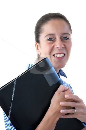 Middle Aged Business Woman Smiling Holding a File stock photo, Middle aged business woman smiling holding a black file on a white background by Keith Wilson