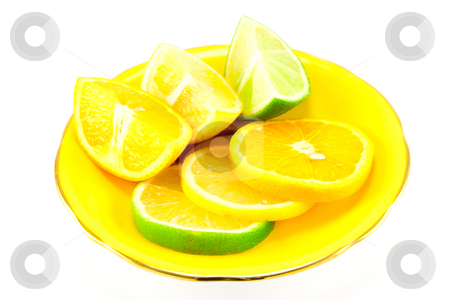 Citrus Fruit on a Yellow Plate stock photo, Assortment of lemon, lime and orange segments on a fancy yellow plate with a white background by Keith Wilson