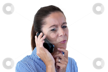 Middle Aged Business Woman Thinking While on the Phone stock photo, Middle aged business woman thinking while talking on the phone on a white background by Keith Wilson