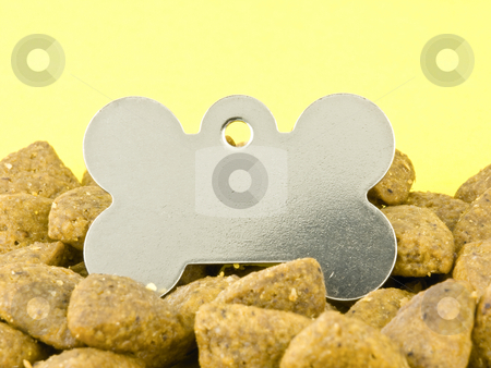 Blank dog tag stock photo, Blank Dog Tag in Kibble on a Yellow Background by John Teeter