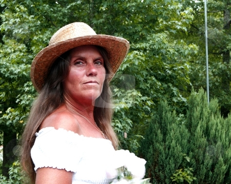 Pretty senior woman stock photo, Pretty senior woman wearing straw hat by Shirley Mathews