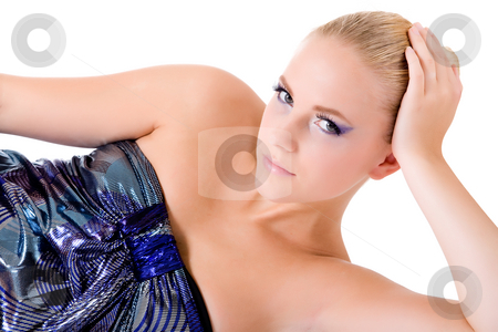 Are you looking at me while lying here stock photo, Blond model in shiny blue dress lying comfortabely and looking at the viewer.