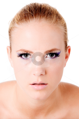 Concentrate and look deeply into my eyes stock photo, Close portrait of a blond model looking like she is hypnotizing you.