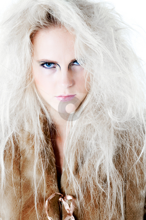 Wild angry fierce look in fur at you stock photo, Model with wild white hair giving the viewer a fierce and agry look.