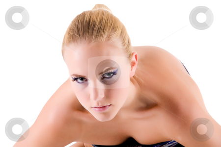 I am looking closely at you stock photo, Blond model bending towards the viewer while looking into the eyes.
