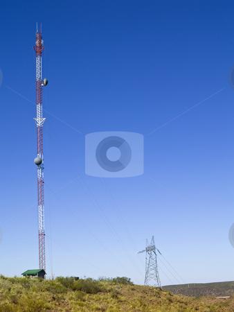 Cellular antenna stock photo, Cellular communication antenna on a blue sky background. by Ignacio Gonzalez Prado