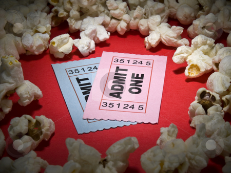 Movie stub stock photo, Close up shot of two generic admission tickets surrounded by popcorns. by Ignacio Gonzalez Prado
