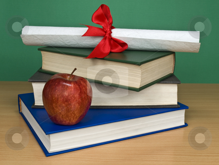 Graduation kit stock photo, A pile of books, an apple and a diploma. by Ignacio Gonzalez Prado