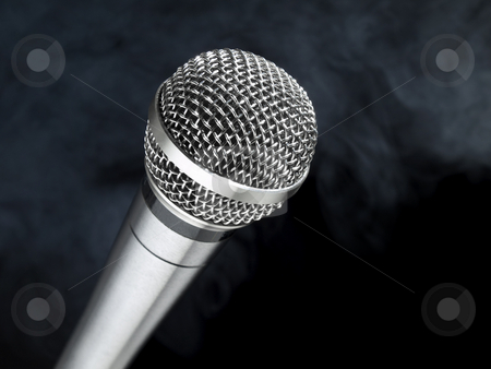 Microphone on stage stock photo, A dynamic microphone over a black and smoky background. by Ignacio Gonzalez Prado