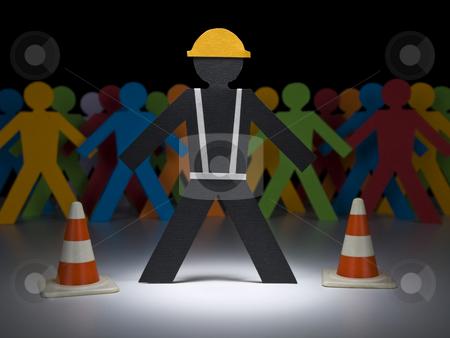 Paper men at work stock photo, A paper construction worker stands under the spotlight before a multicolor crew. by Ignacio Gonzalez Prado