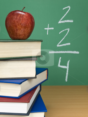 Basic sum stock photo, An addition on the chalkboard with an apple on top of a pile of books. by Ignacio Gonzalez Prado