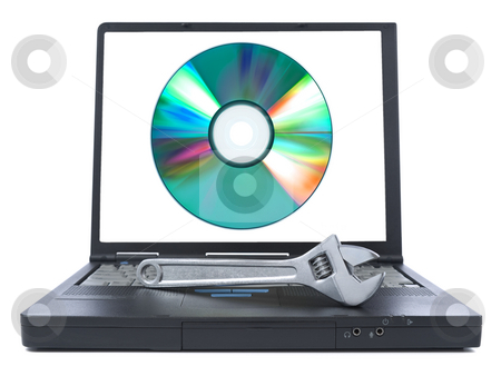 Install solutions stock photo, Isolated black laptop with a spanner over it and a digital disc on the screen. by Ignacio Gonzalez Prado