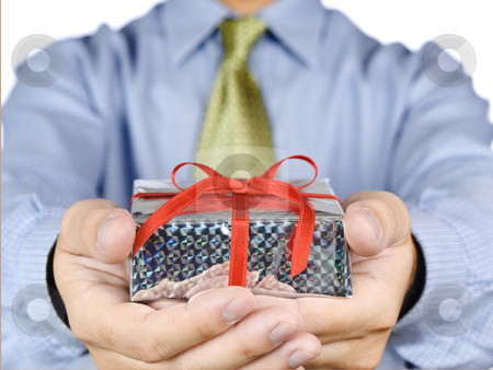 A present for you. stock photo, Office guy holding a gift with a red satin bow. by Ignacio Gonzalez Prado