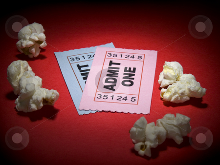Movie stub stock photo, Close up shot of two generic admission tickets and some popcorns arround. by Ignacio Gonzalez Prado