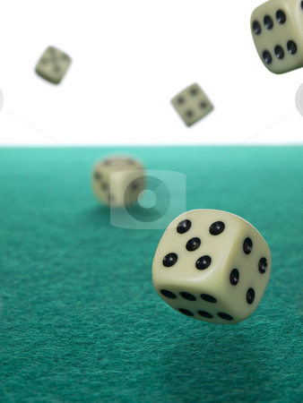 Let's roll stock photo, Five dices rolling over a green felt. by Ignacio Gonzalez Prado