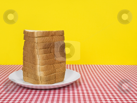 Bread tower stock photo, Sliced loaf of bread served on a table. Copy space on the right. by Ignacio Gonzalez Prado