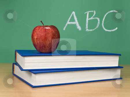 ABC stock photo, ABC written on a chalkboard with an apple over books. by Ignacio Gonzalez Prado