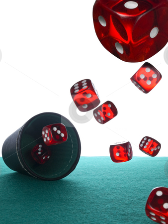 Dices and shaker stock photo, Many red dices are thrown from the shaker over the felt. by Ignacio Gonzalez Prado