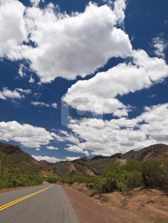 On the road stock photo, Driving on a road through a mountain landscape. by Ignacio Gonzalez Prado