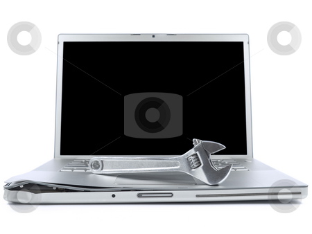Computer maintenance stock photo, A spanner over a damaged laptop isolated over white background. Black copy space on screen. by Ignacio Gonzalez Prado