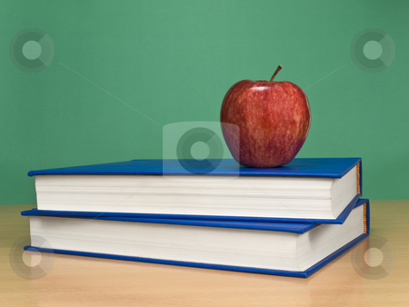 Blank chalkboard stock photo, A blank chalkboard with an apple over books. by Ignacio Gonzalez Prado