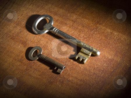Two old keys stock photo, Two obsoletes keys over a wooden table. by Ignacio Gonzalez Prado