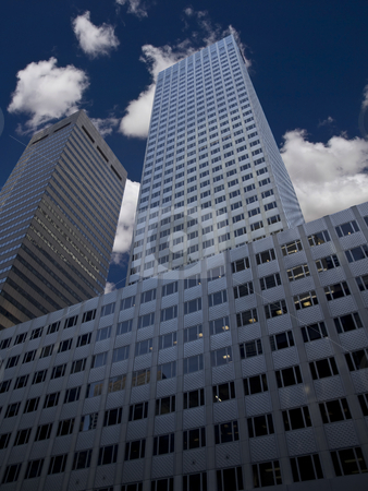 Skyscraper stock photo, New York skyscraper against a blue sky and some clouds. by Ignacio Gonzalez Prado