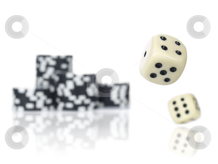 Rolling dices stock photo, Pair of dice rolling in front of stacked black poker chips. by Ignacio Gonzalez Prado