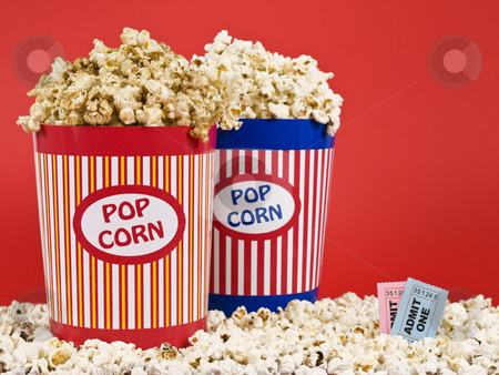 Two popcorn buckets stock photo, Two popcorn buckets over a red background. by Ignacio Gonzalez Prado