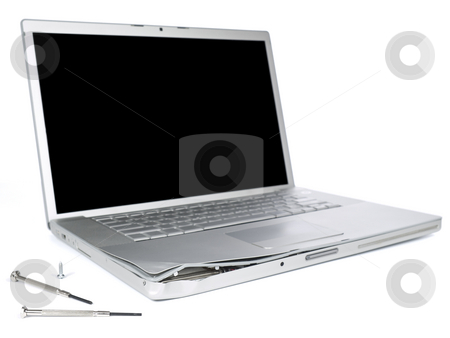 Damaged laptop stock photo, A damage laptop computer is about to be fixed with a pair of clockwork screwdrivers. Isolated on white. by Ignacio Gonzalez Prado