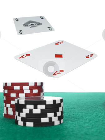 Flying aces stock photo, Two aces flying over the poker table. Red and black chips on the foreground. by Ignacio Gonzalez Prado