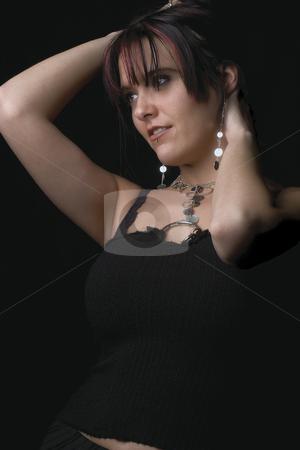 Fashion model - Holding hair stock photo, Twenty something fashion model holding hair looking side ways by Yann Poirier