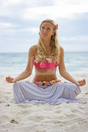 Meditation stock photo, Young happy blonde in relaxing pose on the beach by Dmitry Rostovtsev
