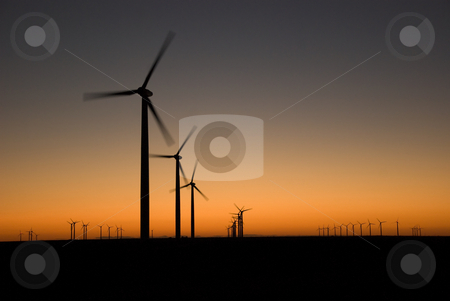 Evening Glow stock photo, Evening last glow on a field of a wind farm by Charles Buegeler