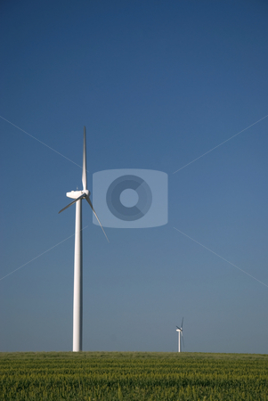 Blue Green and White stock photo, Wind turbine isolated in green field with blue sky. by Charles Buegeler