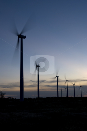 Blades in the Wind stock photo, Blades are moving in the wind and generatoring electricity. by Charles Buegeler