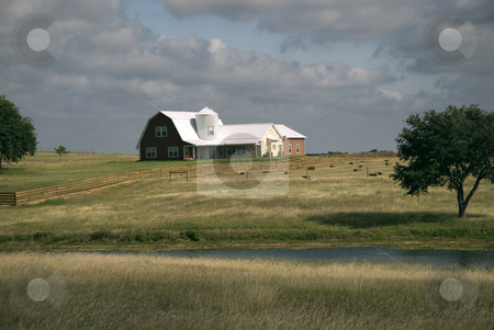 Is it a Barn or House stock photo, It is a ranch house on the open hillside country. by Charles Buegeler