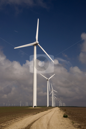 Down the Road stock photo, Wind turbines in a line down the service road. by Charles Buegeler