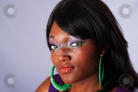 Beautiful face of African woman stock photo, Face portrait of a young beautiful African-American woman with purple-green makeup with long straight black hair, isolated by Paul Hakimata