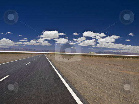 Hitting the road stock photo, A straight road to the salt mine. Blurred by the motion. by Ignacio Gonzalez Prado