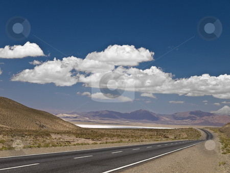 Desert road stock photo, A long road across the desert. by Ignacio Gonzalez Prado