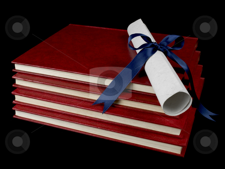 Diploma over books stock photo, A diploma with blue ribbon over several books. Isolated on black. by Ignacio Gonzalez Prado